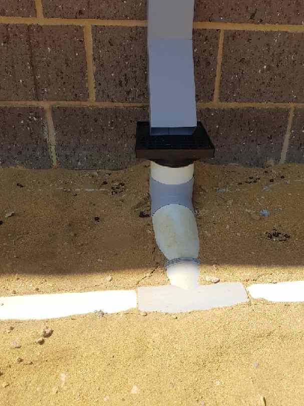 close up picture of storm water pipe not properly installed into the ground
